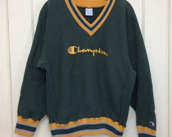 1990s Champion Reverse Weave pullover V-neck sweatshirt size large dark green striped cuffs embroidered logo made in USA