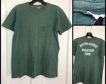 1960s faded green Boston Harbor Marathon Swim Fruit of the Loom all cotton pocket tee size medium 18x23.5 perfectly worn in sports souvenir