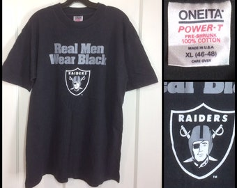 1990s Oakland Raiders football team t-shirt size XL 21.75x28.5 all cotton made in USA faded black NFL
