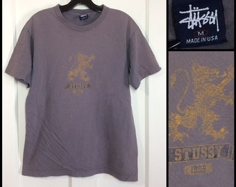 1990s Stussy lion faded gray cotton t-shirt size medium 19.5x25.5 made in USA very used street wear