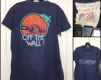 1970s distressed faded printed pocket tee Guadeloupe Off the Wall Vans surfboard Fruit of the Loom thin cotton t-shirt size XL 21x27 surfer