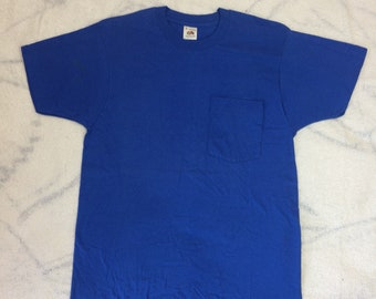 1980s Fruit of the Loom pocket tee t-shirt size medium 18x27 blue all cotton made in USA plain blank single stitch NOS