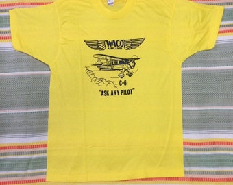 deadstock 1980s Waco C-6 vintage aircraft airplane biplane t-shirt size XL 20x27 pilot aviator yellow tee Screen Stars made in USA NOS
