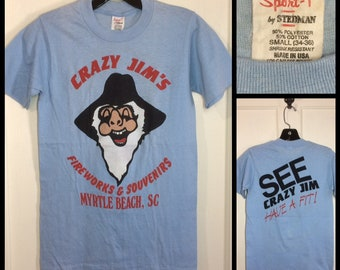 1980s Crazy Jim's Fireworks and Souvenirs Myrtle Beach South Carolina cartoon advertisement t-shirt size small, looks XS 15x24 light blue