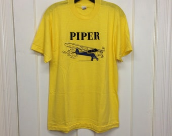deadstock 1980s Piper small vintage airplane t-shirt size large 20x27.5 pilot aviator aircraft thin yellow Screen Stars tee made in USA NOS