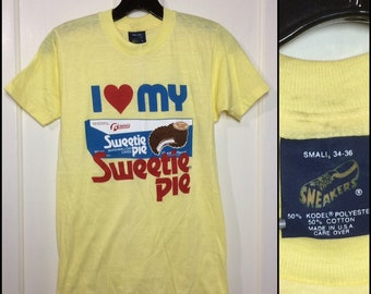 Deadstock 1980s I love my Sweetie Pie marshmallow cakes advertisement t-shirt size small looks XS 15x24 yellow thin Sneakers made in USA NOS