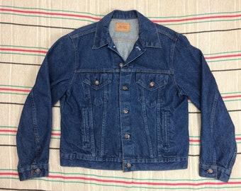 1980s Levis 4 pocket blue jean jacket size 44 large cut tab dark wash cotton denim made in USA #951