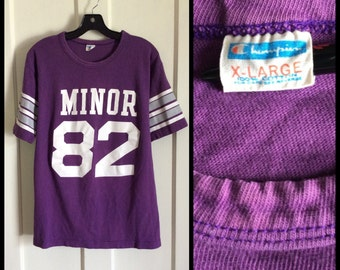 1970s Minor 82 t-shirt size XL, looks large 20.5x26.5 Champion Blue Bar all cotton purple football Jersey white striped sleeves made in USA