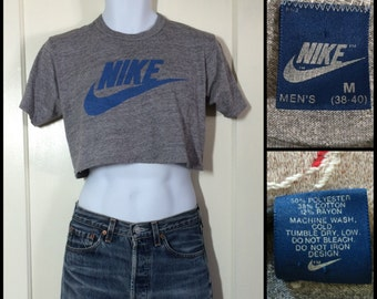 1980's soft faded Nike Brand Swoosh blue Tag Label cropped belly T-shirt size Medium 18x14 Tri Blend heather Gray made in USA