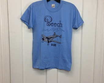 deadstock 1980s Beech D18S vintage airplane t-shirt size boys 14-16 15x22 pilot aircraft blue silver print Screen Stars made in USA NOS