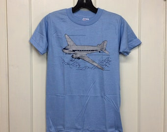 deadstock 1980s vintage airplane t-shirt size boys 14-16 14.5x23 pilot aircraft light blue silver print Hanes made in USA NOS