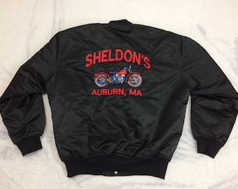 1980s Sheldon's Motorcycles Auburn MA embroidered jacket size large quilted black satin bomber made in USA Harley Davidson NOS deadstock