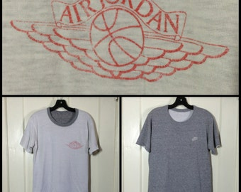 AJ1 1980s blue tag Nike Air Jordan basketball wings T-shirt size Medium 20x25 made in USA Reversible tee worn soft faded White Heather Gray
