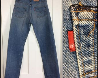 1980s Levi's faded blue 501 button fly jeans label reads 33X36, measures 31x32 original hem, Straight Leg denim made in USA Boyfriend #317