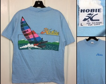 1980s 1989 Hobie windsurfing outrigger surfer beach t-shirt size large 19x25 light blue cotton bright color print summer sports made in USA
