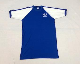 1970s Adidas trefoil logo t-shirt made in USA size Medium 18x27 baseball style tee striped sleeves blue white 2 tone
