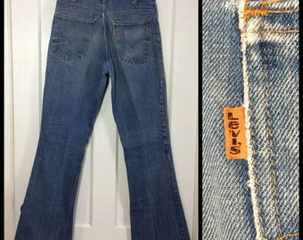 distressed 1970's Levi's 646 orange tab measures 30x32 faded Blue Denim Bell Bottom Flare boyfriend Jeans Scovill zipper #39 button #283