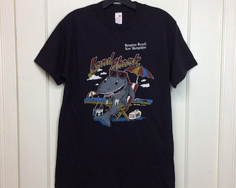 1980s deadstock Land Shark partying Hampton Beach NH souvenir t-shirt size XL, looks medium 18x27 drinking cocktails surfer made in USA