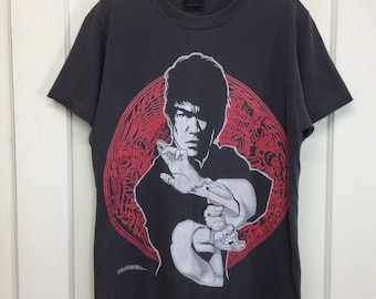 1990s Bruce Lee kung fu martial arts t-shirt size medium 19x26 distressed destroyed faded glow in th dark print single stitch made in USA