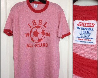 1980s dated 1986 IGSL soccer all stars tri-blend ringer t-shirt size large 18.5x25.5 heather red rayon team sports made in USA