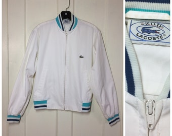 Vintage 1970's Izod Lacoste Alligator Jacket looks size Small feels 60/40 cotton nylon blend, white with blue turquoise striped cuffs