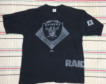 1990s Oakland Raiders NFL football team t-shirt size XL 23x29 Starter tee Metall-X silver print faded black cotton single stitch made in USA