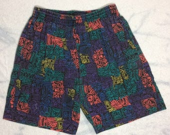 1990s neon Surf Gear board shorts swim trunks looks size small day glow black light abstract face patterned