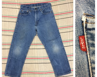 1970s Levis 505 straight leg denim blue jeans tag size 31x30, measures 29x25 made in USA #5 button Talon zipper black bar stitch faded #389