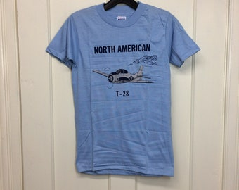 deadstock 1980s North American T-28 USAF airplane t-shirt size boys 14-16 15x23 pilot aircraft light blue silver print Hanes made in USA NOS