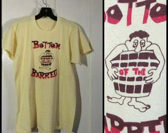 Vintage 1970's Bottom of the Barrell humor cartoon T-shirt looks size Medium 18x24 yellow Hobo beer killroy