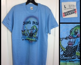1980s Johns Pass 1985 Seafood Festival cartoon fish beer souvenir t-shirt size large 19x27 airbrush Screen Stars Florida beach surfer foodie