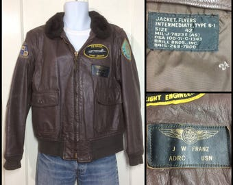 1970s USN G1 goatskin leather bomber flight jacket brown size 42 by Brill Bros. US Navy military 7823E as with patches Orion Engineer Franz
