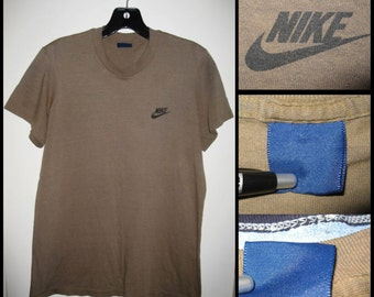 1980's Nike all caps Brand Swoosh Military Army Green Blue Tag Label very soft T-shirt looks size Medium 19x25.5