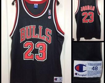 1990s Michael Jordan Chicago Bulls number 23 Black Red NBA basketball team Champion brand jersey tank top size 48 XL