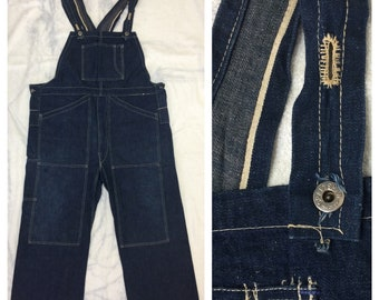 1920s 1930s indigo blue wide leg 1 pocket bib overalls by Craftsman 42x24 selvedge everywhere donut hole buttons no outer seams on the legs