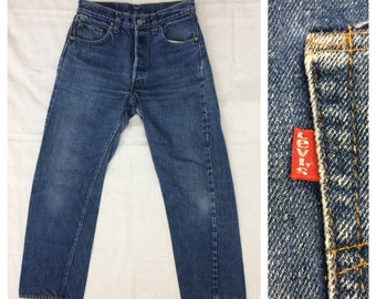 1970s Levis 501 indigo blue jeans tag size 29x29 measures 27x26 redline selvedge denim single stitch number 6 button black bar stitch #1228