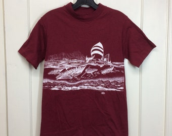 1980s Hawaii whales cotton souvenir t-shirt size small 16x24 Hanes single stitch made in USA outrigger surfer burgundy wraparound print