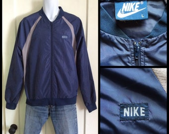 Vintage 1980's Nike Block Letters logo Blue Label Sports windbreaker Jacket size Large