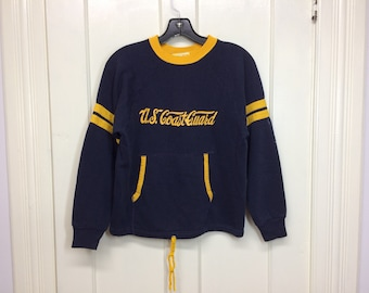 1970s US Coast Guard sweatshirt with drawstring front pocket and striped sleeves size medium, looks small navy blue yellow