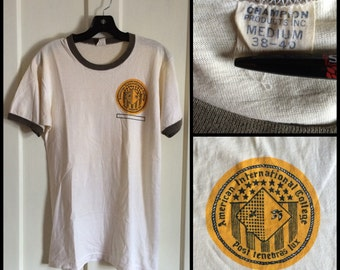 Vintage 1960s Champion AIC American International College cotton t-shirt size Medium
