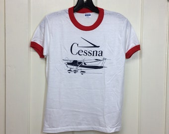 deadstock 1980s Cessna vintage small airplane t-shirt size youth 14-16 16x21 pilot aircraft thin white red ringer tee Hanes made in USA NOS