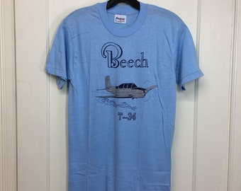 deadstock 1980s Beech T34 vintage airplane t-shirt size medium 17x27 pilot aircraft light blue silver print Stedman tee made in USA NOS