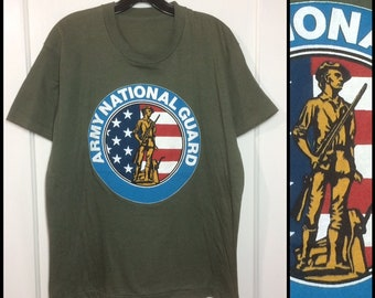1980s US Army National Guard t-shirt looks size large 21x26.5 soft olive green USA military soldier flag honor veterans