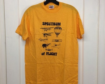 deadstock 1980s Spectrum of Flight airplanes hot air balloons t-shirt size medium 18x27 aircraft yellow cotton Hanes made in USA NOS