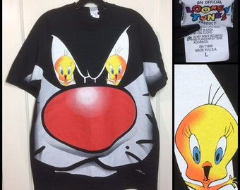 1990's 1997 Sylvester the Cat and Tweety Bird Looney Tunes Cartoon character all over print black t-shirt size large 21x28 Space Jam