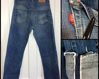 distressed Levi's 505 Indigo Blue denim single stitch redline selvedge #5 button 32X30, measures 32x28.5 raw hem boyfriend jeans USA #319