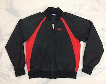 AJ1 1980s 1985 Air Jordan 1 wings nylon warm up jacket size youth/ kids medium black with red stripes original AJ-1 blue tag Nike