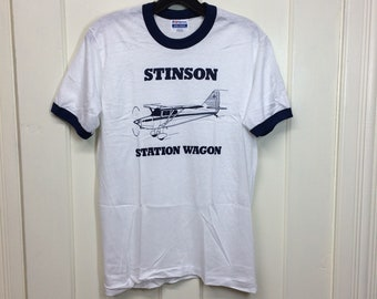 deadstock 1980s Stinson Station Wagon vintage airplane t-shirt size medium 17x25 pilot aircraft thin white ringer tee Hanes made in USA NOS