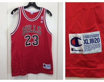 a9da8b998a49 1990s Michael Jordan Chicago Bulls number 23 red black NBA basketball team  Champion brand jersey tank top size Youth XL 18-20
