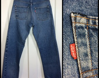 faded Levi's 505 34X30, measures 32x29 Straight Leg 1980's made in USA black bar stitch denim Boyfriend blue jeans #314